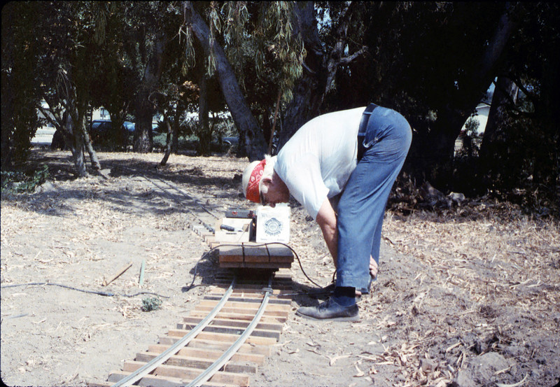 Paul Conover helps with the miniature-railroad track construction, 6/1987 acc2005.001.0809