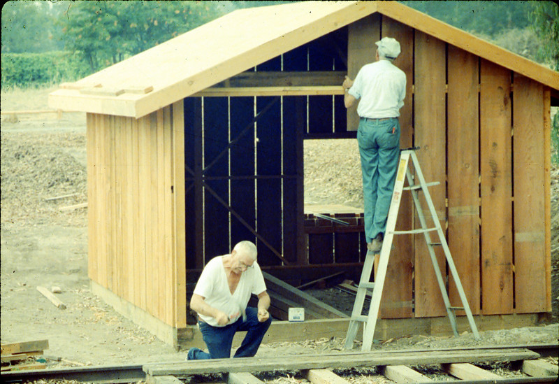 Completing the train shed (Elmer Coombs and Gene Allen), 1990. acc2005.001.1429