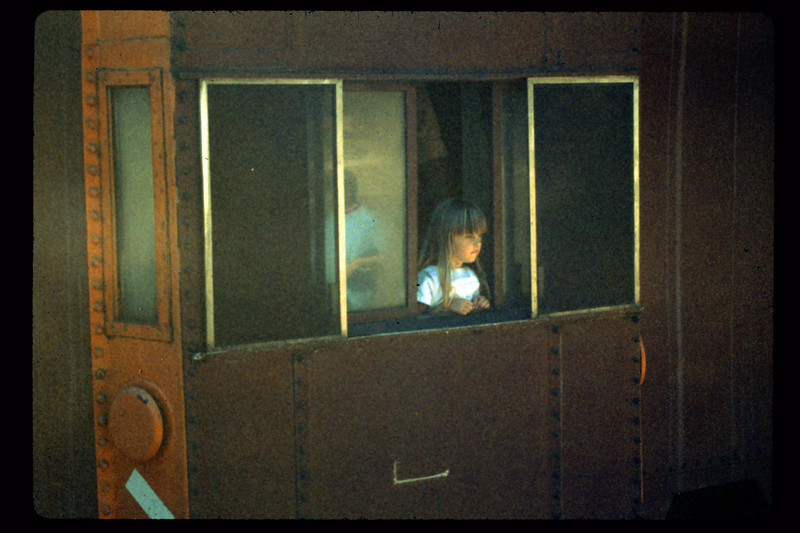 Depot Day young visitor in caboose, 10/1990. acc2005.001.1397