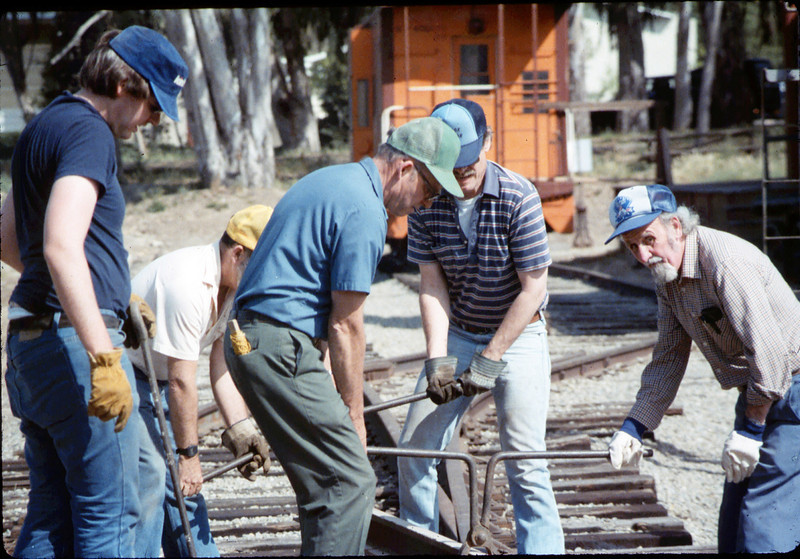 Track extension construction crew -- Ralph Moore, Gene Boswell, Malcolm Alexander, Scott Moore, and Perry Adams, 4/18/1987. acc2005.001.0755