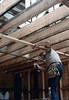 """Carpenter """"Paul"""" prepares Freight Room ceiling, 6/1982. acc2005.001.0253"""
