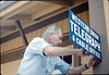 Gene Allen installs replica Western Union telegraph sign on Goleta Depot, 5/1989. acc2005.001.1189