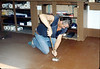 John Morelli applies new flooring in Freight Office, 9/1983. acc2005.001.0414
