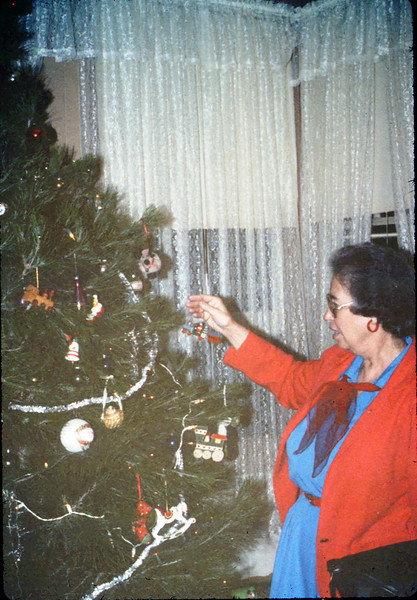 Dolores Hartnett helps decorate the Goleta Depot Christmas tree, 12/1987. acc2005.001.0889