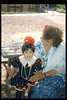 """El Tren De La Fiesta"" event (Alice Jaramillo and granddaughter) was held Aug. 7, 1993. acc2005.001.1842"