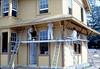 Painter's Union men return to apply trim, 9/1982. acc2005.001.0319