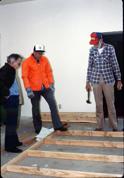 Construction of the museum's model-railroad exhibit (Bill Cormack, left, Bill Everett, and Ray Baird), 1/1985. acc2005.001.0470