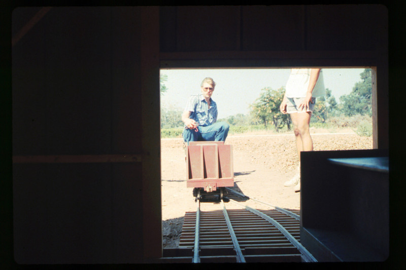 Putting the train away in the new shed (Mike Williams and Steve Kramer), 1990. acc2005.001.1436