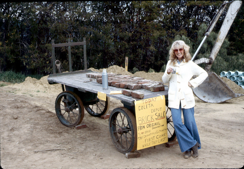 Phyllis Olsen selling Goleta Depot bricks, Feb. 1982. acc2005.001.0150