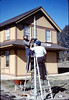 Gene Allen and Glen Apers install train-order post, 2/1987. acc2005.001.0693