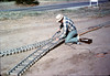 George Potter installs a switch for the miniature-railroad, 10/1986. acc2005.001.0647