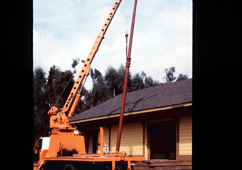 Specialty Crane & Rigging truck raises train-order pole for re-installation (Gene Allen is watching), 10/1983. acc2005.001.0427