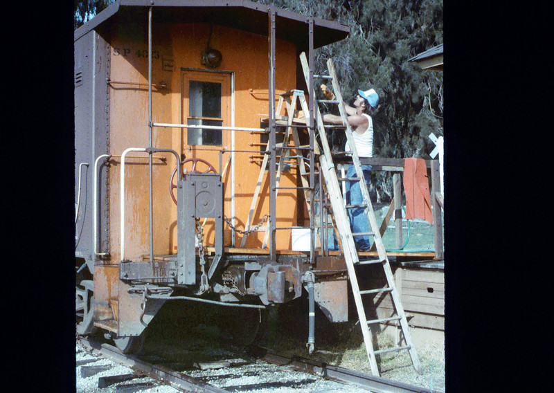 Ron Robinson cleans Caboose 4023, 12/1986 acc2005.001.0659