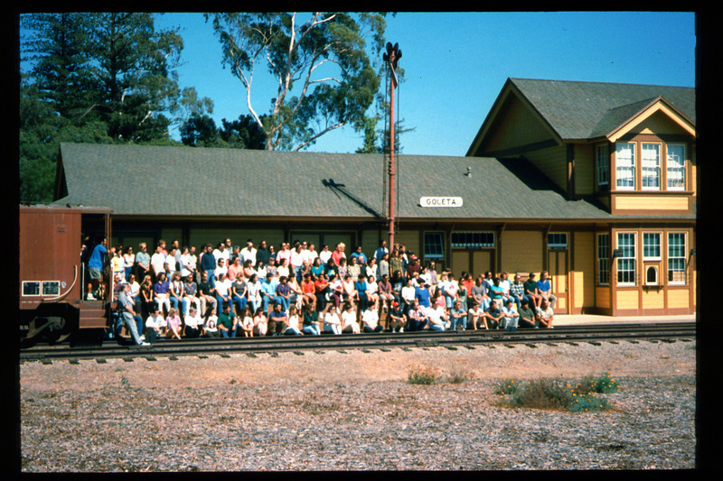 Medical Concepts Inc., a Goleta-based research firm, used Goleta Depot recently as the setting for its company photograph. All operations at company headquarters on Cremona Drive were brought to a halt for more than an hour on the afternoon of Sept. 14, 1994, while the entire staff car-pooled to the railroad museum. The final photograph captured 140 Medical Concepts employees assembled on Goleta Depot's loading dock, including workers at all levels. acc2005.001.2007