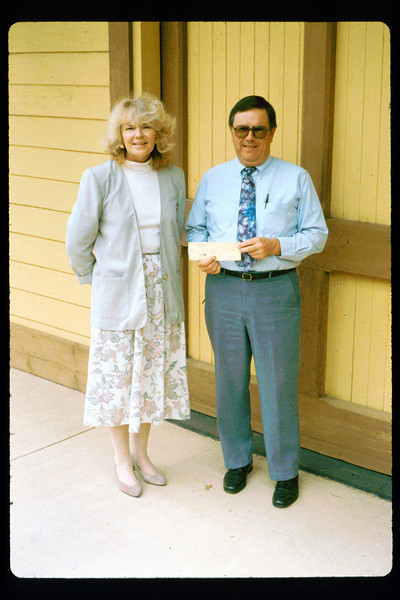 Bruce Schumikowski presents check from ?Goleta Lions (Santa Barbara News-Press?) to Phyllis Olsen, 1991. acc2005.001.1505