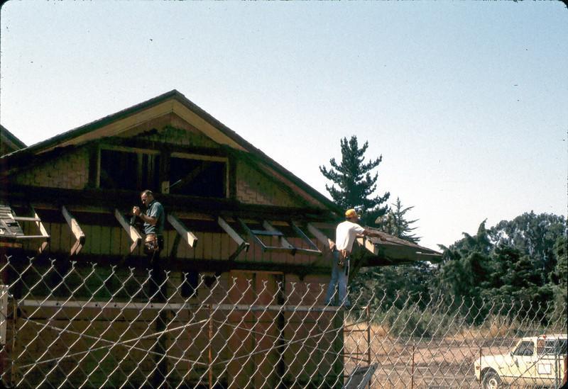 Repairing eave, 6/1982. acc2005.001.0216