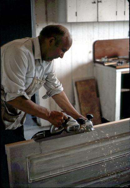 Ernie Thomsen works on one of the upstairs doors, 7 or 8/1982. acc2005.001.0275