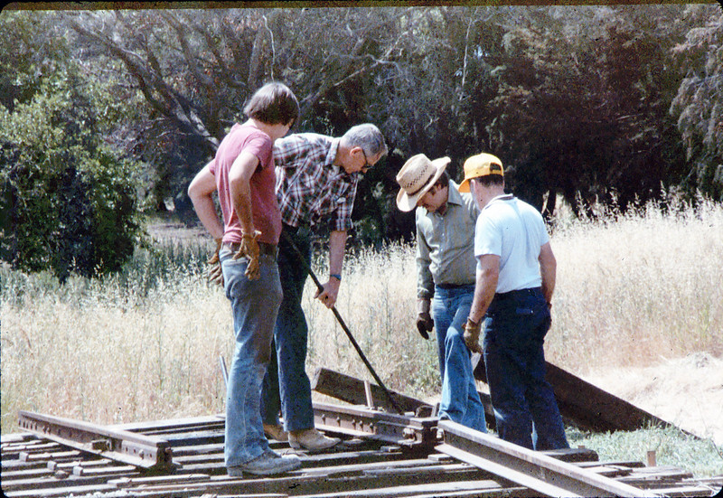 Laying of the standard-gauge track (Scott Moore, Gene Allen, John Lebeck, gene Boswell), 5/11/1985. acc2005.001.0499