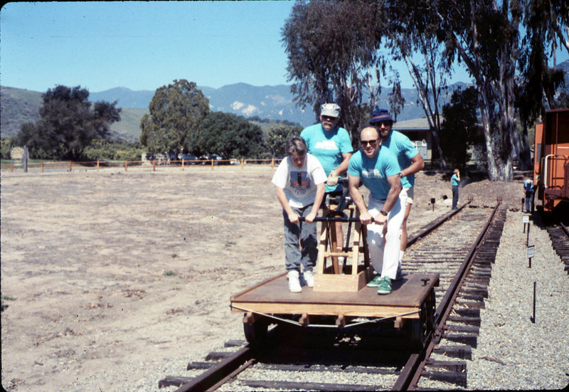 Asphalt Regatta spring fundraiser (handcar and riders), 3/17/1990. acc2005.001.1305