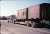 Caboose body is moved by truck from La Patera to museum grounds, 9/25/1986 acc2005.001.0625