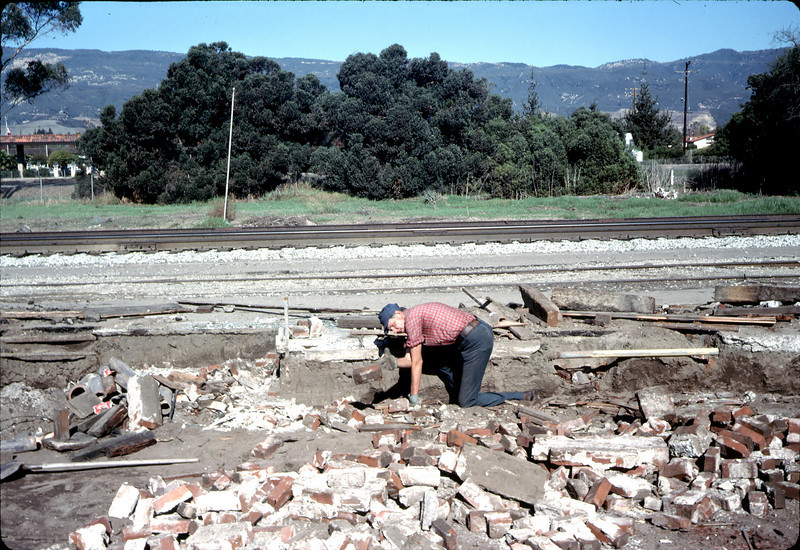 Salvaging bricks from old depot site, 11/19/1981. Gene Allen. acc2005.001.0107