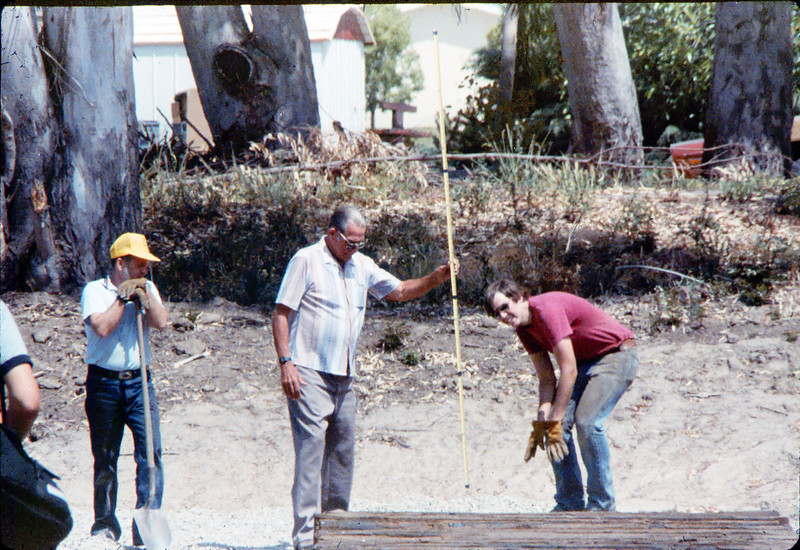 Laying of the standard-gauge track (Gene Boswell, left, Capt. Rodman, Scott Moore, right), 5/11/1985 acc2005.001.0493