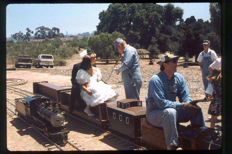 Wedding party rides the miniature train during Steaming Summer, 1991. acc2005.001.1480