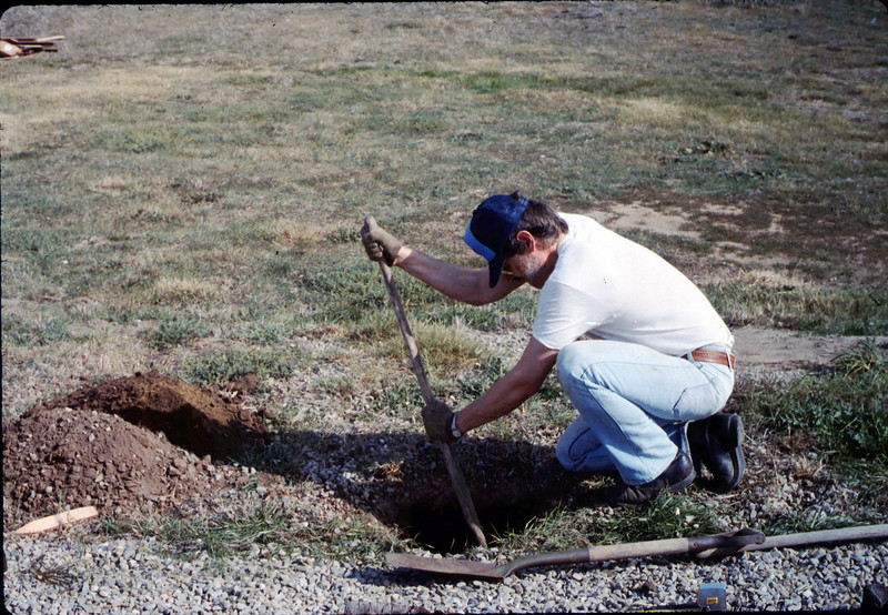 Perry Adams digs the hole for the train-order pole that was moved from Santa Barbara station, 1/1987. acc2005.001.0665