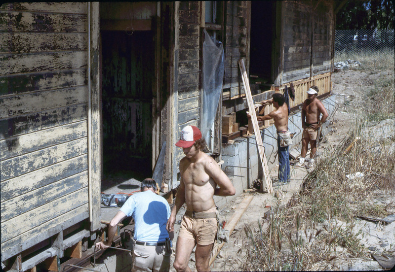 Apprentice carpenters at work (Ray Baird in shirt), 5/1982. acc2005.001.0213