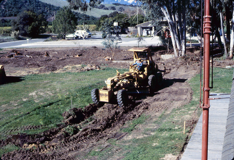Banner Construction crew grades in preparation for standard-gauge track construction in front of Goleta Depot, 1/1985. acc2005.001.0465B
