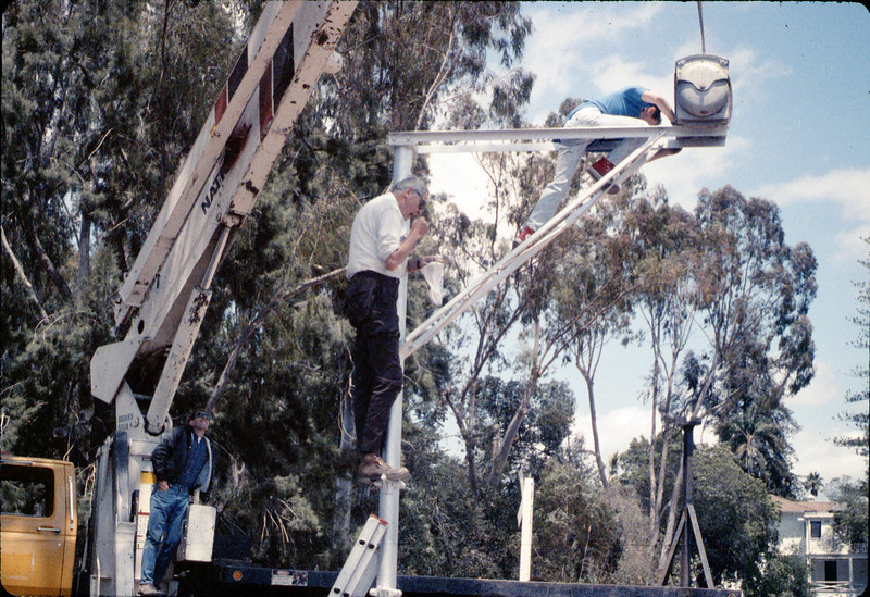 Seth Hammond, Gene Allen and Colin Hammond install the wig-wag signal, 5/1989. acc2005.001.1185