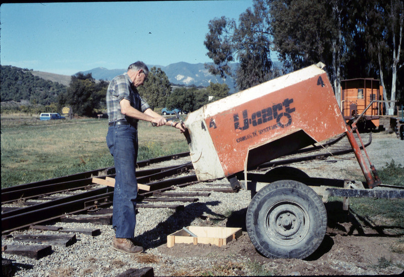 Gene Allen pours foundation for train-order pole from Santa Barbara station, 1/1987 acc2005.001.0676