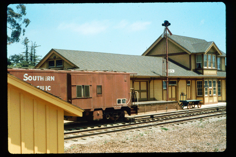 Goleta Depot (west side), shed,  and caboose, 1991. acc2005.001.1499
