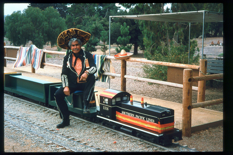"Engineer Al Jaramillo helped run ""El Tren De La Fiesta,"" Aug. 7, 1993. acc2005.001.1834"