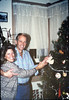 Bill and Kentha Wallace help decorate the Goleta Depot Christmas tree, 12/1987. edit acc2005.001.0890