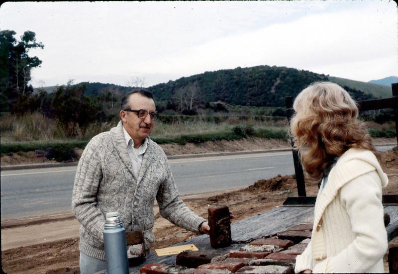 Phyllis Olsen sells a depot brick, 2/1982. acc2005.001.0167