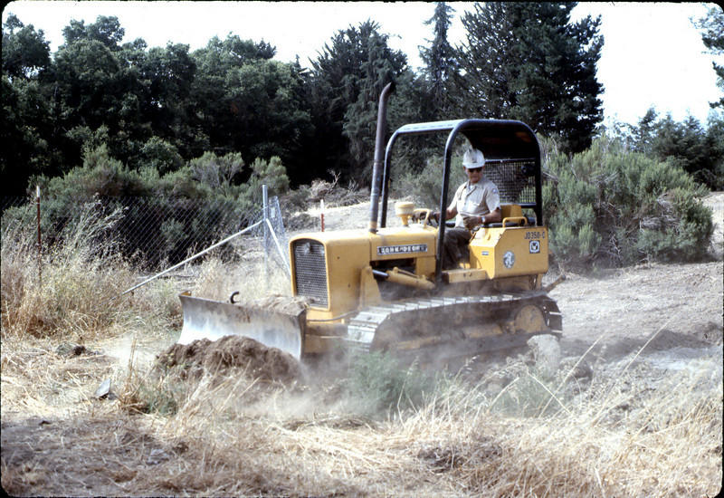 County worker backfills foundation, 6/1982. acc2005.001.0254