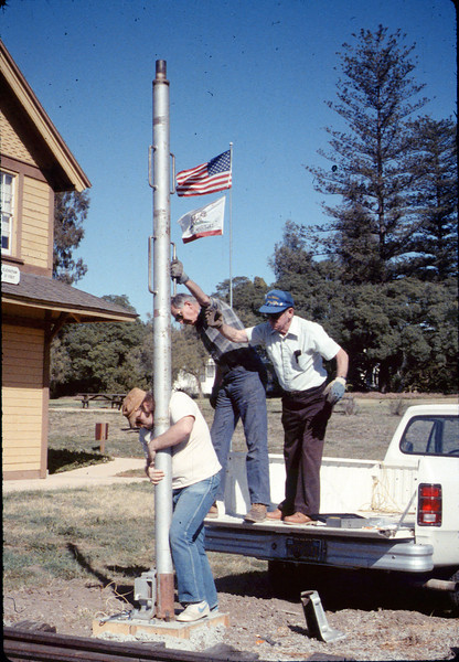 Gene Allen, Glen Apers and Glen's son install train-order post, 2/1987. acc2005.001.0691