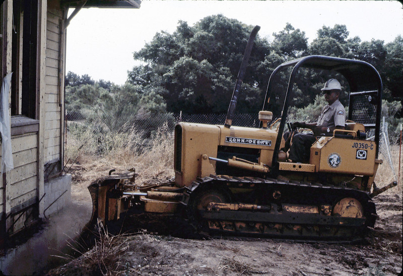 County worker backfills foundation, 6/1982. acc2005.001.0256