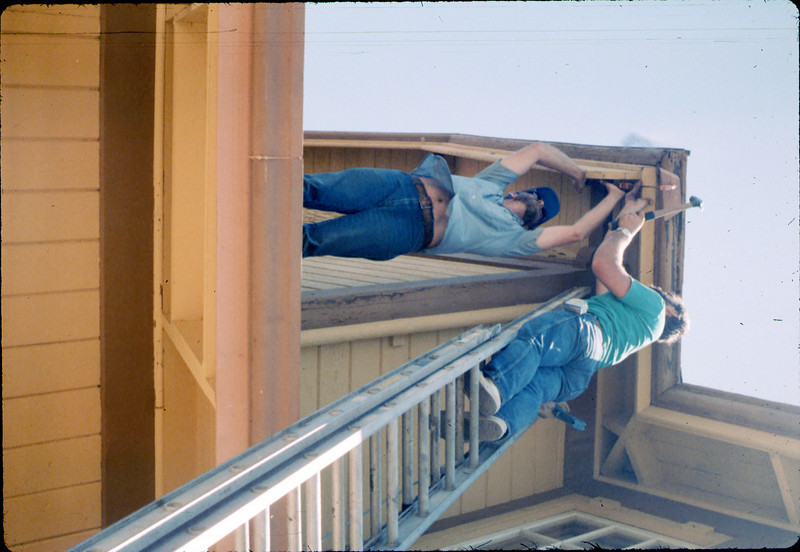 M&M Construction installs new redwood gutters, 5/1988. acc2005.001.0981