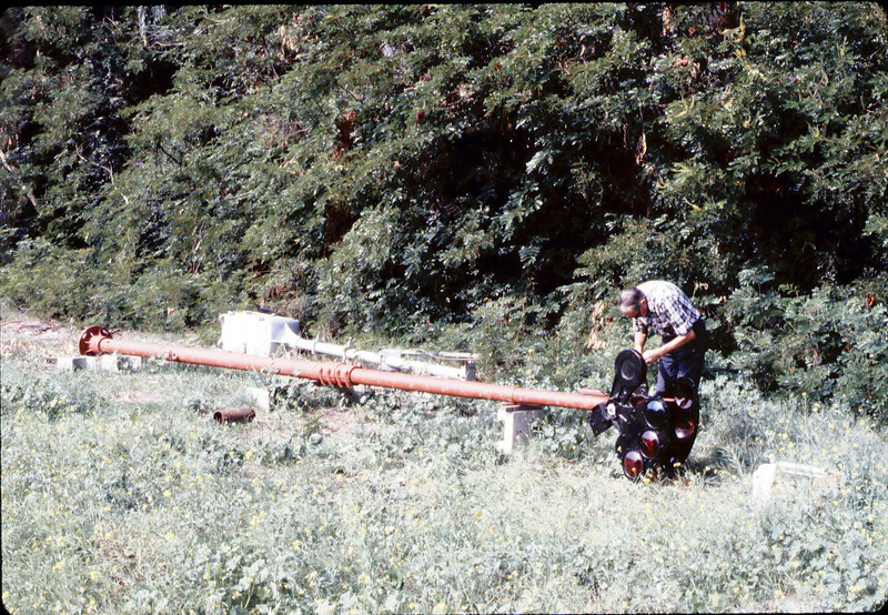 Gene Allen prepares train-order pole for re-installation, 10/1983. acc2005.001.0420