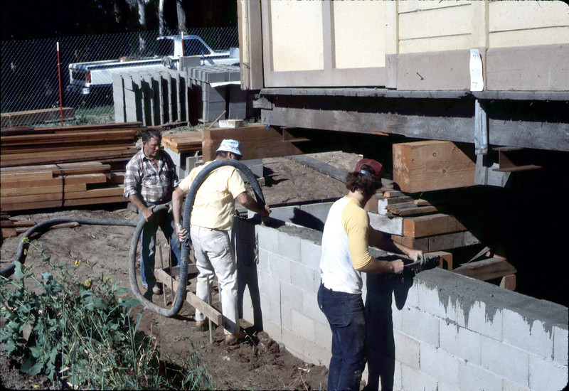 Filling foundation block with concrete, Feb. 1982. acc2005.001.0159