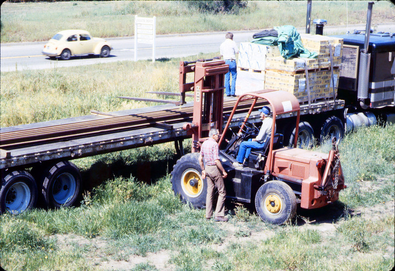 Laying of the standard-gauge track (Gene Allen; Ed Lebeck on forklift; John Lebeck on truck), 4/2/1985 acc2005.001.0480