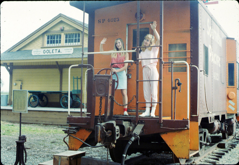 Heather and Stephanie Coombs pose on the caboose, 3/7/1987. acc2005.001.0705