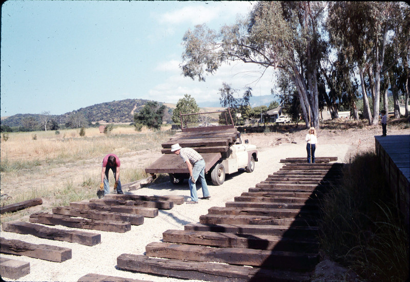 Laying of the standard-gauge track (Scott Moore, Gene Rantanen, Phyllis Olsen), 5/11/1985. acc2005.001.0498