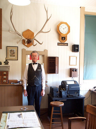 Museum docent Bob Burtness poses in Freight Office.