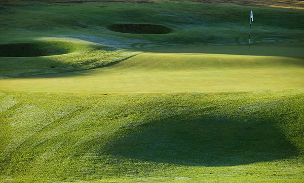 Bumps, hollows, pot bunkers, 18th green, Muriwai