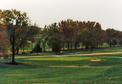 "The 5th green hasn't change much.  Actually, the green and bunker are the ""originals"".  This is another image from 1982/83."