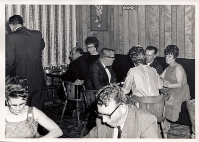Dining in what appears to be the old member bar.  Bud Hanks is seated with his back to us.  Joe Pedalupe' is the man with his back to Bud in the black rimmed glasses.