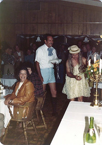 Maurice Niemann as the ring bearer and Hap Hasker as the flower girl approach the head table.
